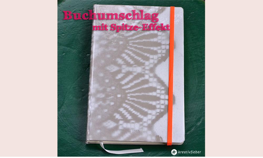buch_spitzeumschlag