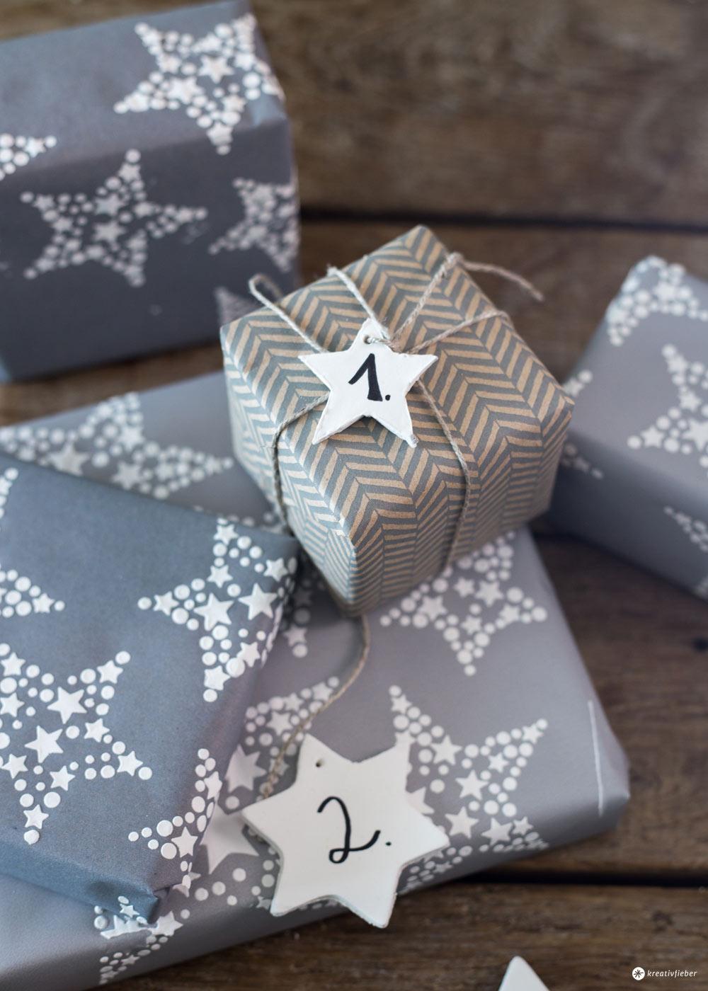 DIY Adventskalender Verpackung mit Sternen - upcycling Geschenkpapier