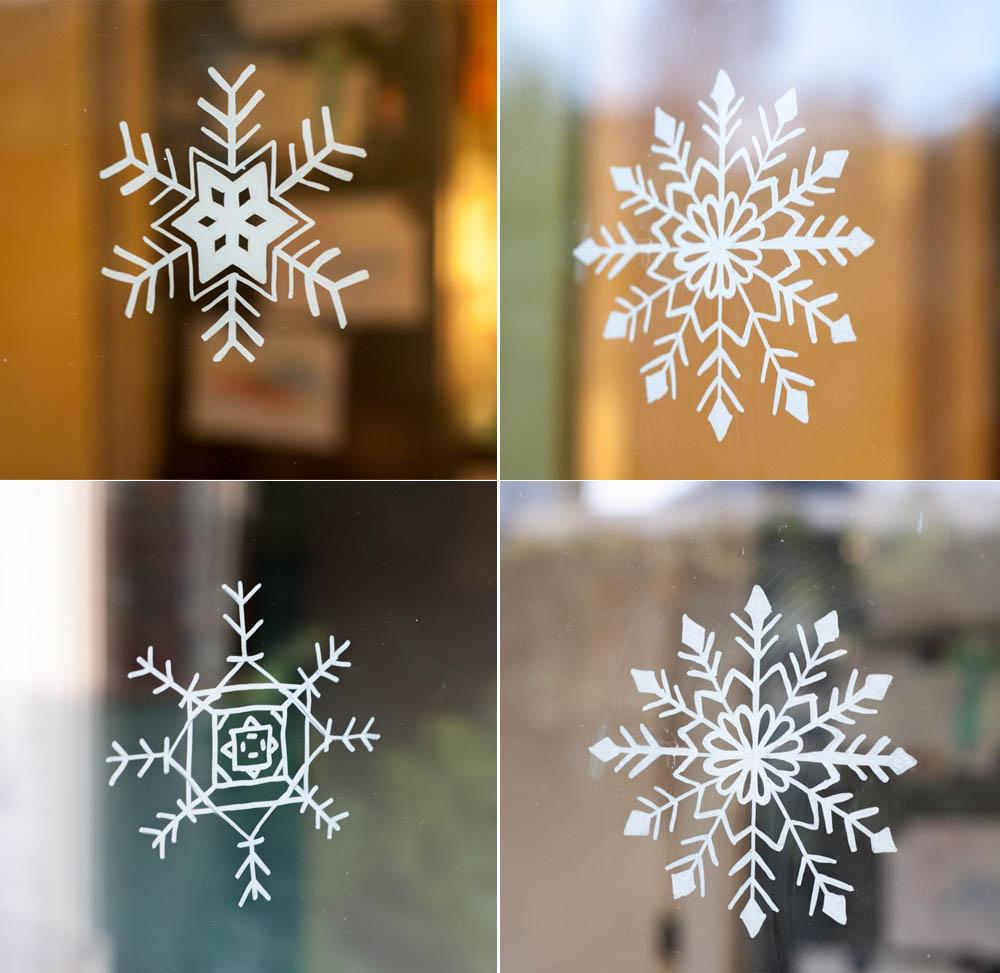 Schneeflocken auf Fenster malen